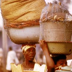 Woman and Her Daughter Going to Market Carrying Wares on Head