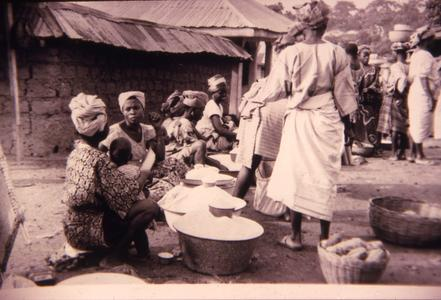 Women at market selling gari