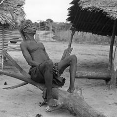 Older Booli Man of Kasai Leaning Against a Backrest