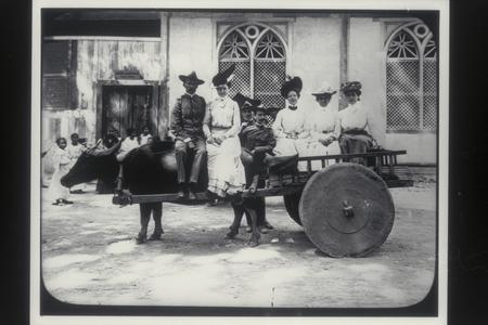 U.S. officers and women on carabao, 1900-1901