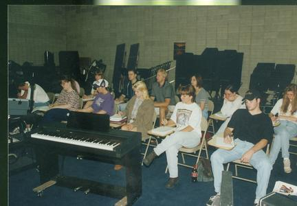 Students take notes in music class