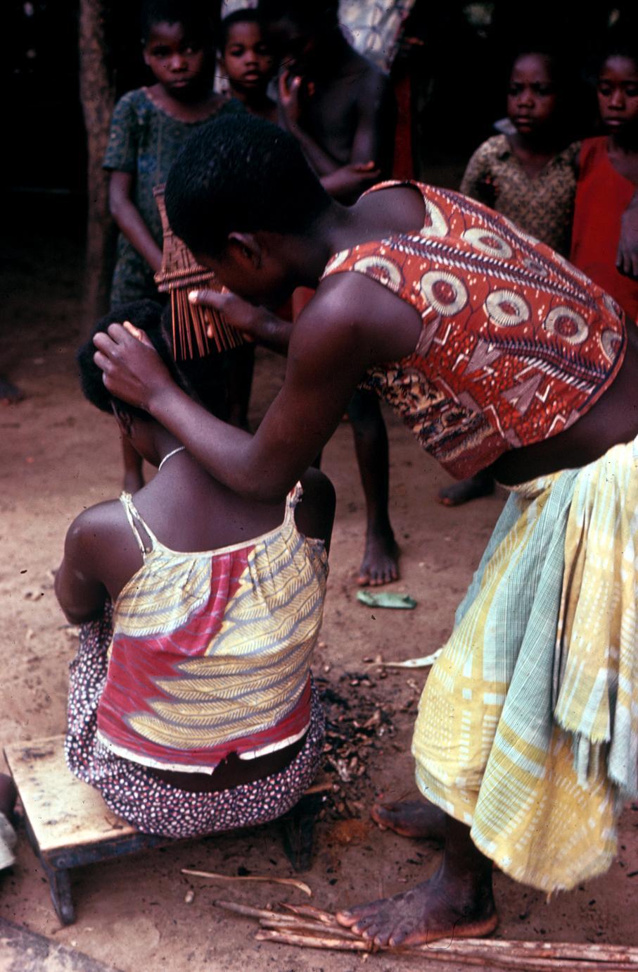 Women Combing Hair