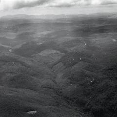 Aerial view of the eastern portion of the Boloven Plateau looking towards Phou Luang mountain in Attapu Province