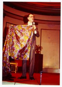Charles Kleibacker holding fabric