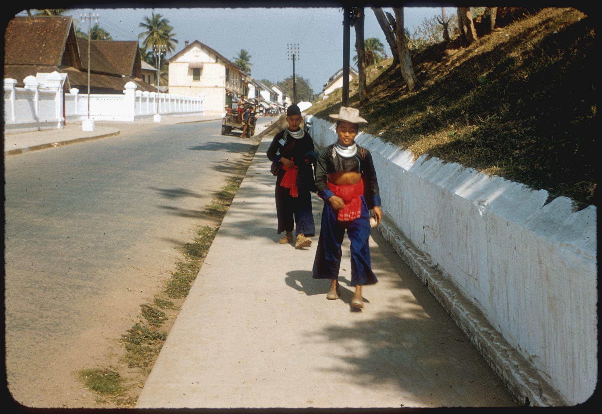 Two Hmong (Meo) men on main street.