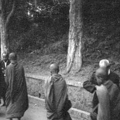 Morning laymen standing, providing food for monks