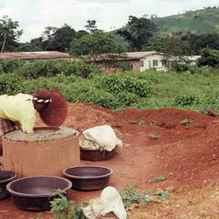 Woman getting water from well
