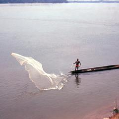 Fisherman Casting Net on the Ubangi River