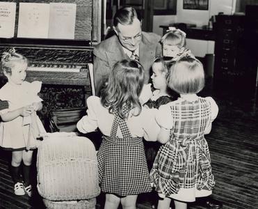 Nursery school children with Stout president