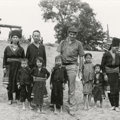 Jacques Lemoine, well-known French anthropologist, stands with Blue Hmong (Hmong Njua) villagers in a Blue Hmong village in the area of Muang Vang Vieng in Vientiane Province