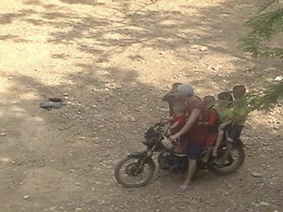 Man with kids on a motorcycle