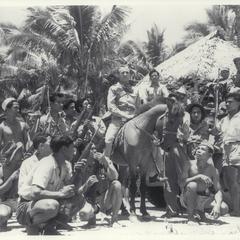 Capt. Locolvero on horseback, surrounded by guerrilla forces, Zamboanga, 1945