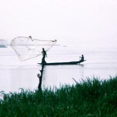 Fisherman Casting His Net from a Pirogue in the Niger River near Niamey