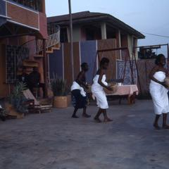 Woman dancers with baskets