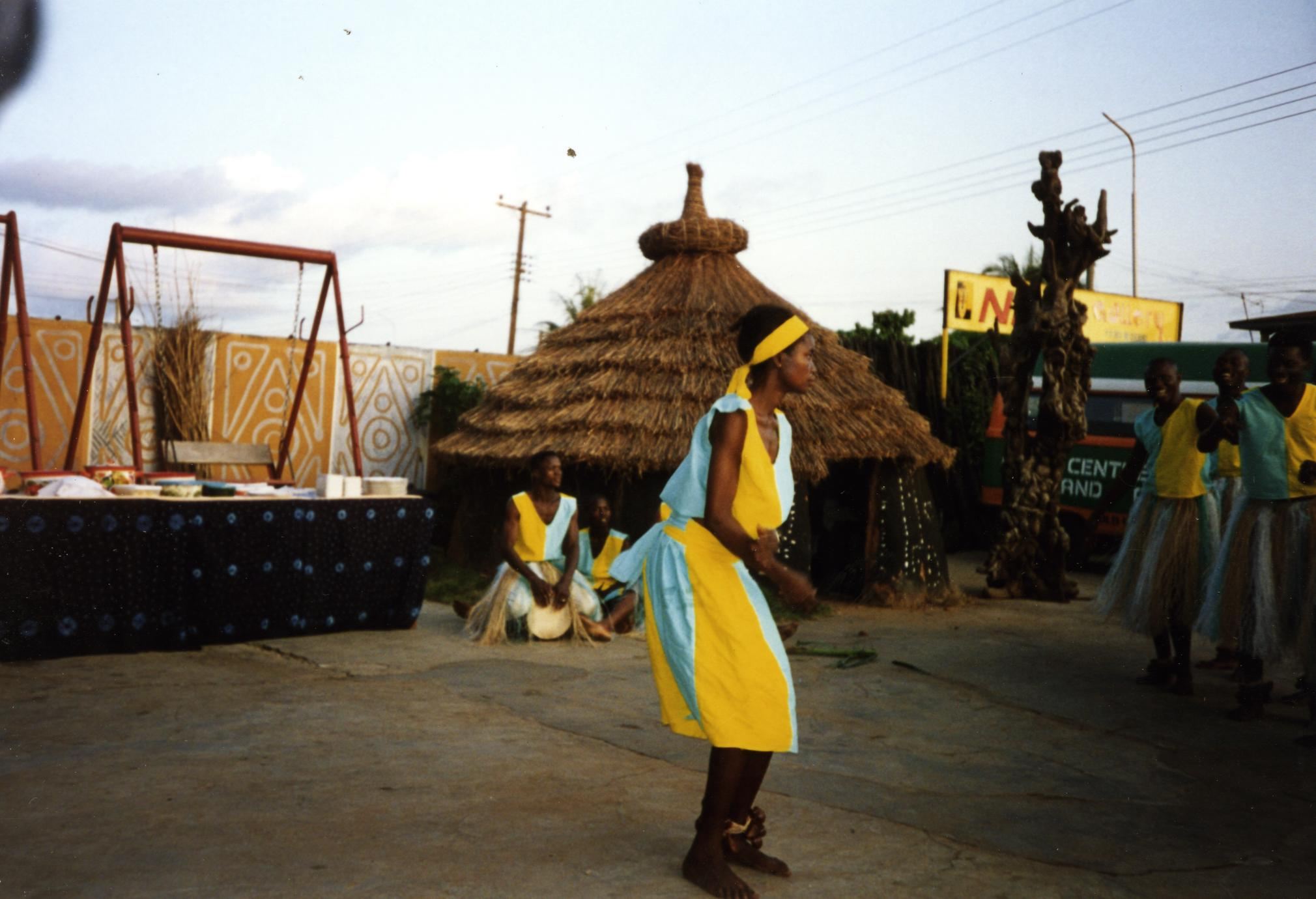 Dancers in yellow and blue