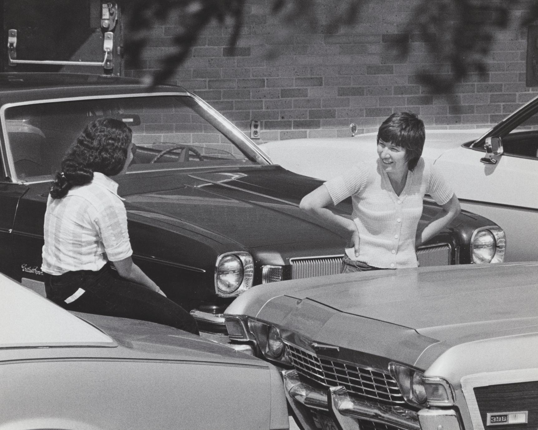 Women in parking lot