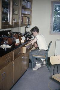 Joseph Koonce counting plankton at microscope