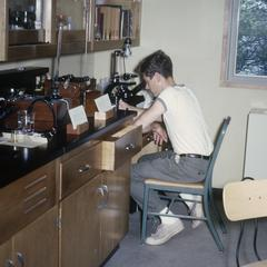 Joseph Koonce counting plankton at microscope