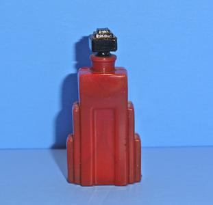 Opaque red glass perfume bottle