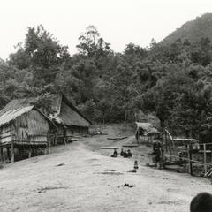 Bue Hmong (Hmong Njua) village with house and rice storage shed on the hillside in the vicinity of Muang Vang Vieng in Vientiane province