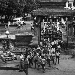 Procession carrying giant candle to vat on the afternoon before the beginning of Phansa