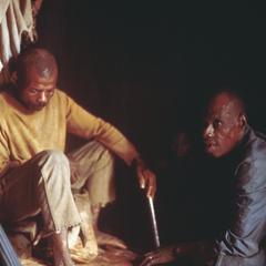 Men Consulting Diviner at Bujan