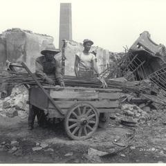 Filipino men salvaging structural steel, Manila, 1945