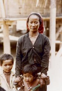 Khmu' mother with two children in a Khmu' village in Houa Khong Province
