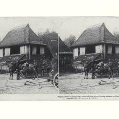 U.S. soldiers stop in front of some thatched Filipino homes, 1899