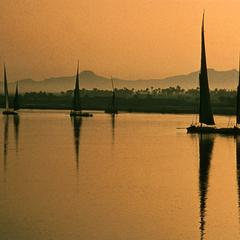 Feluccas (Sailing Boats) on Nile with Mountains Behind