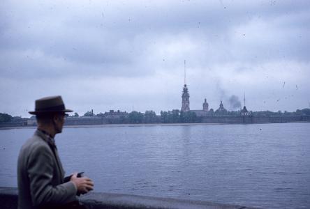 Man standing along banks of river