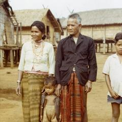 A village headman, his wife and sons pose for a photograph in Attapu Province