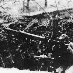 A soldier of the 19th Route Army operating an anti-aircraft gun.