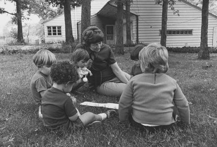 Dorothy Parsons outside with a group of children