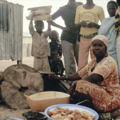 Woman Deep-Frying and Selling Kosai on the Road to the Lycee, Zinder