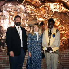 """Agbo Folarin and others in front of his mural, """"Creation of Diversity Myth's"""""""