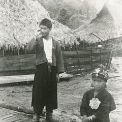Akha youth and little girl, in the village of Phate, Houa Khong Province