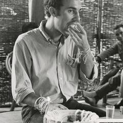 """Bill Sage consumes an egg at a """"baci"""" in Pakxe in Sedone Province"""
