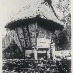 Woman and rice granary, Ilocos Norte, 1920s