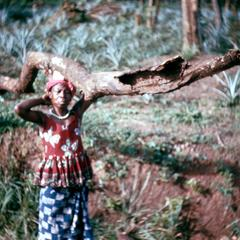Kissi Woman Carrying Firewood to Cook Dinner