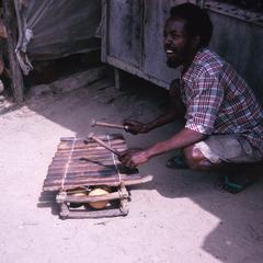 Gambian Musician with Balafon Next to Brickama Woodcarvers