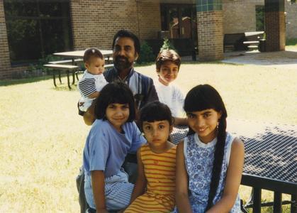 Economics professor Larry Gomes and children