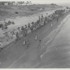 Guerrillas march on beach to LCI, Masbate, 1945