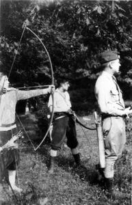 Aldo Leopold and others with bows and arrows