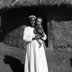 Mother and Child in Front of House