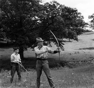 """Carl and Aldo Leopold """"roving"""" with bows and arrows"""