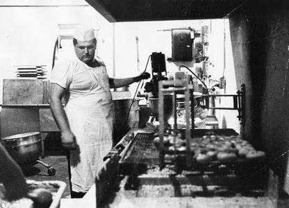 A cook at work, cafeteria kitchen