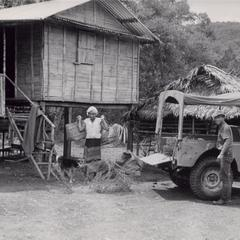 IVS jeep parked in front of Laven house in Houei Kong Cluster in Attapu Province