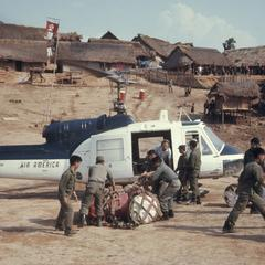 Soldiers loading helicopter