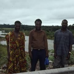 Three men in front of Ibadan Dam